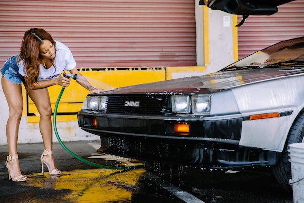 Karrueche Tran washing a DeLorean