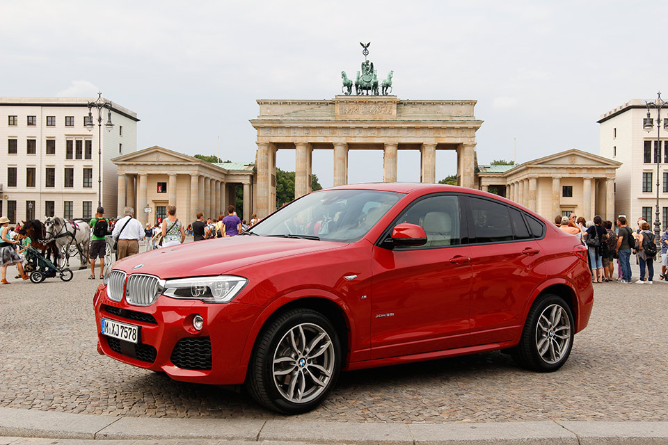 BMW x4 in front of the Brandenburg Gate in Berlin