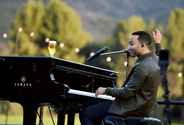 "John Legend Performing at the ""Host Beautifully"" Event"