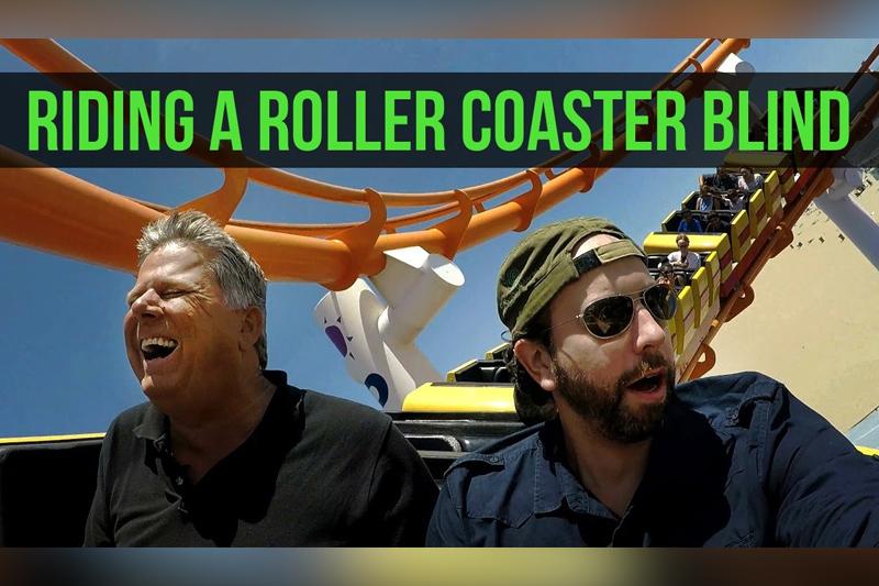 Blind man rides a roller coaster