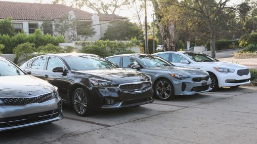 Kia Stinger next to Kia Optima and Cadenza