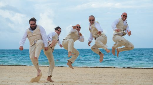 Groomsmen jumping in the air