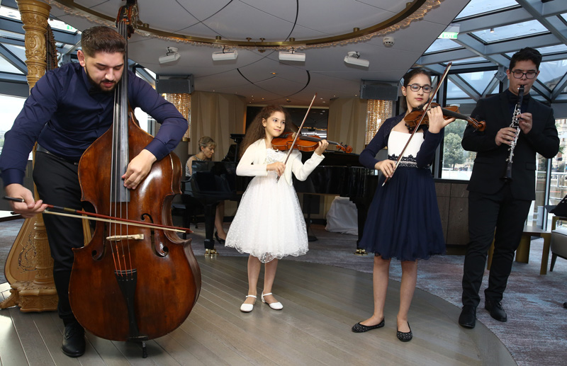 Musicians performing at the Crystal Ravel christening