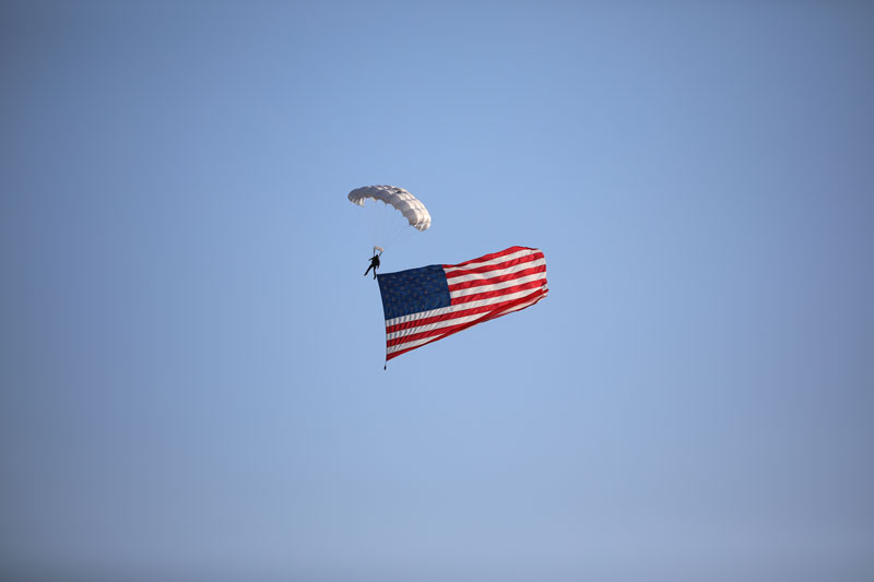 American Flag skydiver over KY Speedway