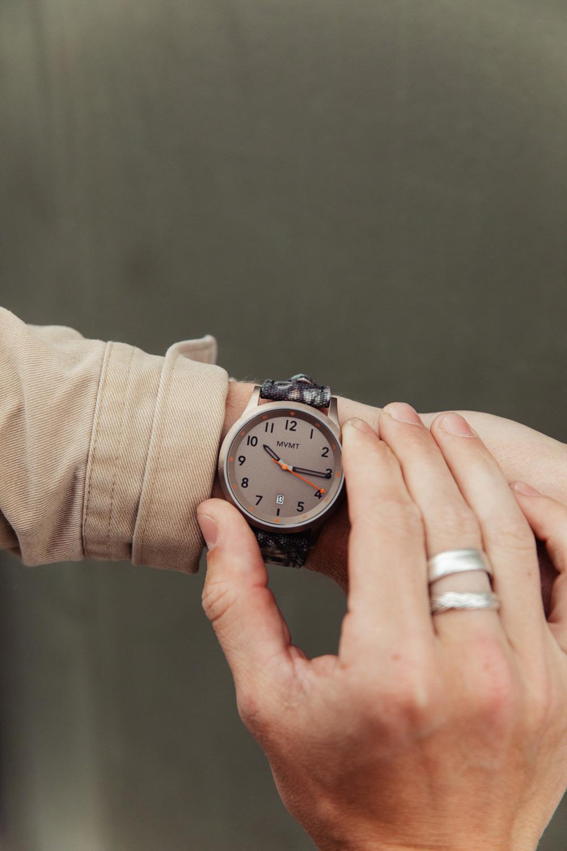 Man checks watch - Field Collection