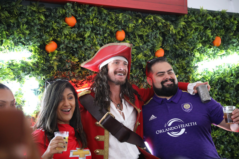 Captain Morgan taking photos with fans at the MLS All-Star game