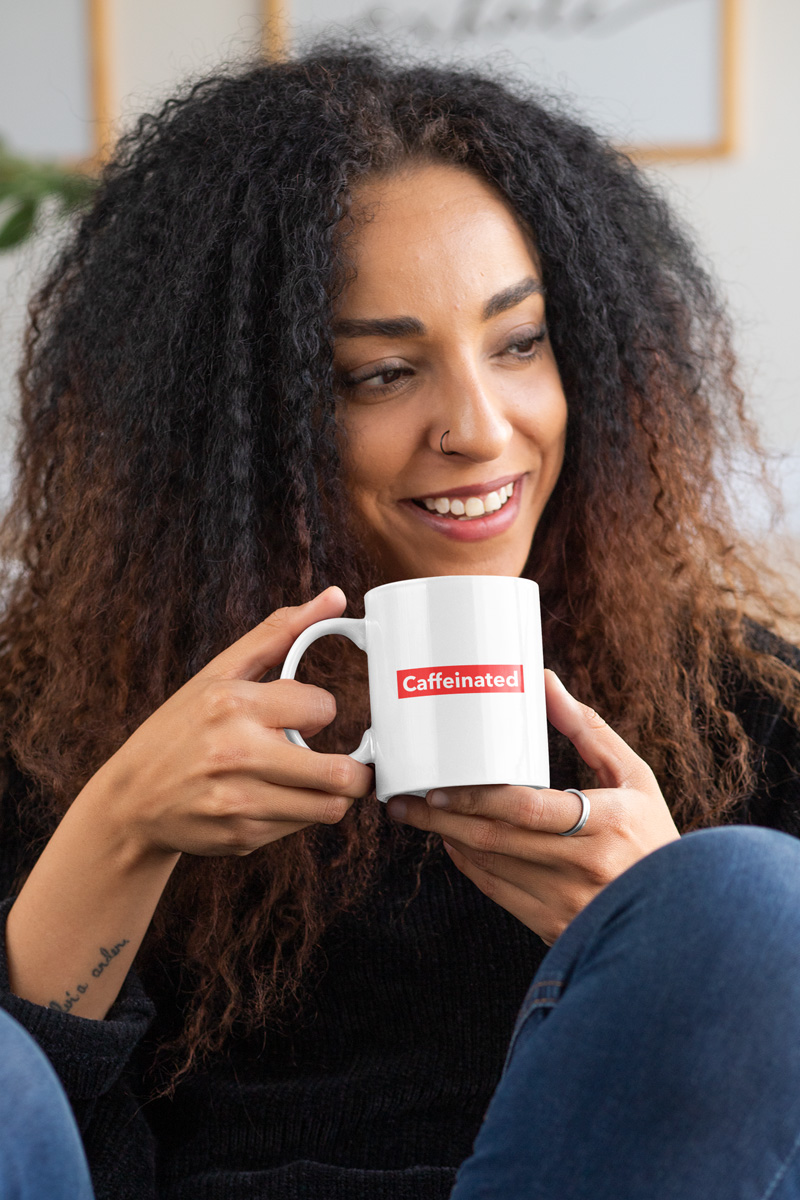 Woman holding caffeinated coffee mug