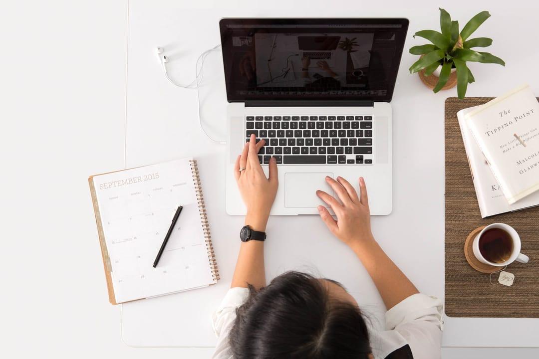Woman at laptop working